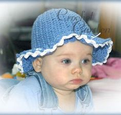 Crocheted baby sun hat. I made a larger ruffled brim, though.