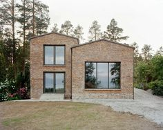Hermansson Hiller Lundberg has completed a brick house for a sloped site in Sweden, featuring staggered interiors based on Adolf Loos' Raumplan concept.