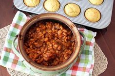 Looking for a new way to cook dried beans? Try this recipe for barbecued baked beans with spicy sausage. These beans are easy to prepare, flavorful, and budget friendly! Baked Beans Crock Pot, Slow Cooker Baked Beans, Homemade Baked Beans, Bean Recipes, Pork Recipes, Vegetable Recipes, Cooking Recipes, Beans And Sausage, Spicy Sausage