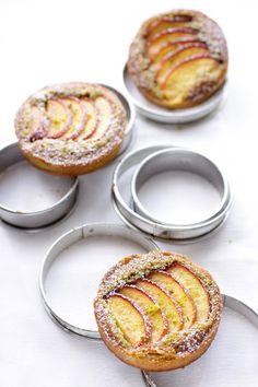 // nectarine pistachio frangipane tarts