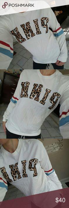 NW0T, cheetah campus tee Never worn cheetah print logo campus long sleeve tee. size small pink Tops Tees - Long Sleeve