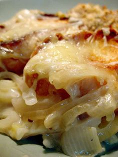 Cheesy Onion Casserole: Original Pinner Wrote: Best Thanksgiving Side Dish Ever!2-3 Tbs butter or margarine  3 large sweet onions or 4 medium white or yellow onions  2 c. shredded Swiss cheese (8 oz.)  1 can cream of chicken soup, undiluted**  2/3 c. milk  1 tsp. soy sauce  8 or so slices of French bread    **You can substitute cream of mushroom soup for cream of chicken to make vegetarian.