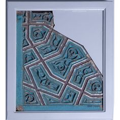 Fragment of a panel of yellowish sandstone, modelled with a countersunk design and covered with enamel colours, Bukhara, Uzbekistan, about 1358. From the tomb of Bayan-Quli Khan (d. 1358) at Fathabad.