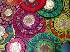 4th grade students did a fantastic job creating radial designs for their Mexican folk art mirrors. 1.They first traced around a circle, then added fun patterns. 2.Outlined with a sharpie, colored in the shapes with construction paper crayons. 3. Added patterns onto copper tooling,(using the silver side to look like a mirror) 4. Glued down the mirror, and added sequins.