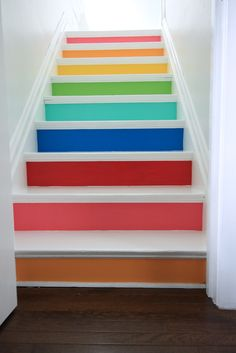 LOVE rainbow stairs for a bonus room staircase or basement - so cheerful and fun!