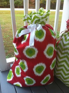 Here's a picture of the bags that I was talking about   Ikat Christmas dot Santa Sack by SewingforAdoptions on Etsy, $30.00