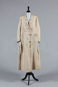 A rare Redfern ivory silk driving/duster coat, circa 1910, large woven label with 26 Conduit Street and 27 New Bond Street addresses, no 40135, the decorative tabs adorned with large buttons, silk loops to fasten