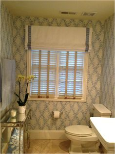 before/after bathroom transformation with Thibaut wallpaper   http://frontdoorfabrics.blogspot.com/2015/03/front-door-files-blue-and-white.html