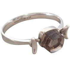 Georg Jensen Cuff with Rutilated Quartz by Vivianna Torun No. 207  http://www.1stdibs.com/jewelry/bracelets/cuff-bracelets/