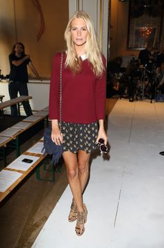 Poppy Delevingne front row at Fashion East in a flowery miniskirt, pullover and brilliant gold Givenchy heels.  Source: wireimage.com