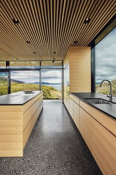 Kitchen Undermount Sink Recessed Lighting Wood Cabinet Wall Oven Cooktops and Concrete Floor The view is framed from every angle. Photo 10 of 13 in A Timber-and-Concrete Summer House in Iceland Boasts Breathtaking Views Concrete Wood, Polished Concrete, Concrete Floors, Concrete Houses, Wood Slat Ceiling, Wooden Ceilings, Ceiling Cladding, Design Hotel, Küchen Design