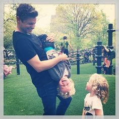 """Pin for Later: Our Top 4 Instagramming Celebrity Moms (and 1 Dad!) of 2014 Clowning Around """"NYC is the bestest,"""" new Harlem, NY, homeowner Neil wrote of this shot of his three favorite people playing in a city park."""
