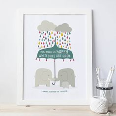 Lovely artwork for a new baby or nursery wall, this print is a great way to express your love for your little one. Available mounted (ready to place straight into a 30x40cm frame), or unmounted (for you to mount and frame as you wish). Our mounted and unmounted prints fit easily into frames which be found on the high street and from that well known Swedish home store. A pair of elephants and their precious baby shelter under a bright umbrella, while little grey clouds shower them with…