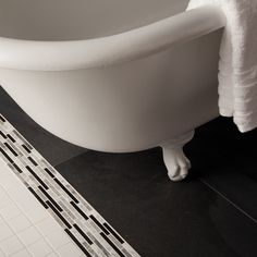 Check out this American Olean product: Photo features Unglazed Porcelain Mosaics in Ice White, and Volcano Rock in Graphite Black 12 x 24 tile with Designer Elegance Empress Accent in Carbon Blend on the floor.