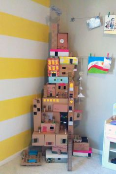 Love this creative, kid-friendly building project! And my son loves to make box houses even more than I do. Nessa Dee: Crafty Friday: The Box House Kids Crafts, Projects For Kids, Diy For Kids, Craft Projects, Kids Fun, House Projects, Craft Ideas, Cardboard Box Houses, Cardboard City