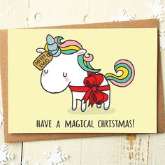 Have A Magical Christmas Unicorn Greeting Card Who wouldnt love a Unicorn for Christmas? Send a friend this pointy donkey with magical rainbow