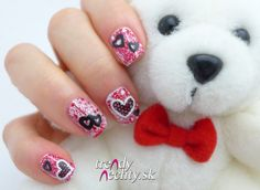 pattern on nails. Red nail polish, valentine manicure