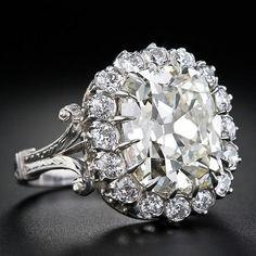 7.02 Carat Antique Cushion Cut Diamond Ring.