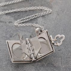 Silver book locket pendant opens to give you four pages for you to personalise it with photographs - an ideal gift for someone else or for yourself! #Otisjaxon #Jewellery #lovedones #giftideas #lockets
