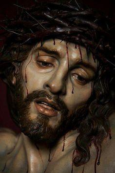Christ of Mercy, sculpture by Jose Maria Ruiz Montes in Malaga Spain: