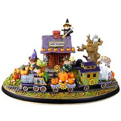 "Pumpkin Junction ~ This special scene is a fun array of Wee Forest Folk during the last spooky days of October. See the ""tricked out"" train and the engineer in his Happy Halloween cap as he and his ghostly conductor deliver pumpkins and candy to Wee Station, USA.  Each is numbered, comes with a Certificate of Authenticity and is signed by Willy & Donna Petersen. Please place your order by September 15, 2013. Click on the color options to see the back. 6 3/8"" x 3 5/8"" x 4"""
