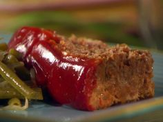 Sunny Anderson from food network Meatloaf. OH MY WORD!!!! It was soooo good, I made it twice and we ate for a week and 1/2. THE BEST MEATLOAF EVER! You will love it. Used extra spicy ketchup with fries the next day and used some to make meatloaf sandwich.