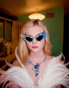 Elle Fanning wears Rodarte's Feather Gown with Swarovski Crystals and Van Cleef & Arpels Necklace in the 2011 issue of A Magazine; styled by Ashley Furnival and Shirley Kurata (photo by Bill Owens).