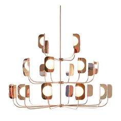 This magnificent chandelier is part of the Leaf collection and features three tiers with lights and shades in hand-worked iron with a polished copper finish. The modern and light shape of this piece was designed by Matteo Zorzenoni and is a perfect complement to any interior decoration.