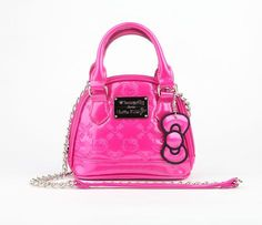 Hello Kitty Embossed Micro Crossbody: Take a peek at this micro crossbody bag; a baby version of the classic Loungefly design. This hot pink faux patent bag features Hello Kitty embossing, metallic bow charm, and chain handle with patent panel. Easily fits your phone, makeup, cards and keys... got to love it for going out with the girls! Faux leather. Black polyester lining. Wipe clean with damp cloth and air dry $55