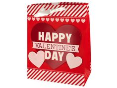 """Perfect for Valentine's Day, this Valentine's Day Striped Gift Bag features a matte red paper bag with a cardstock heart cutout that says """"Happy Valentine's Day"""", a stripes and hearts design and white ribbon handles. Measures approximately 10.5"""" x 5.75"""" x 13"""". Comes loose."""