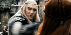Looking at this closely, I think I see Thranduil is breaking her bow. Not slashing her with his sword. Maybe he's angry because she's siding with the dwarves, and maybe using some elves under her command to protect Kili.