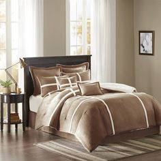 The Madison Park Weston suede bedding set creates a cozy and inviting look to…