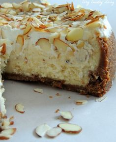Sliced White Chocolate & Almond Amaretto Cheesecake is a great dessert for company or date night. Amaretto Cheesecake, Cheesecake Recipes, Dessert Recipes, Chocolate Cheesecake, Amaretto Cake, Brunch Recipes, Just Desserts, Delicious Desserts, Yummy Food