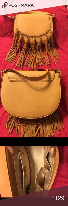 Bebe Sling Bag Bebe Tan sling bag. New without tags, never worn. Purchased recently bebe Bags Crossbody Bags