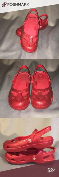 Crocs Red Glitter Sandals Crocs Red Glitter Sandals. Gently used just a few times. Almost brand new. Size J 1. Checkout my other listings and add to a bundle to save! CROCS Shoes Sandals & Flip Flops
