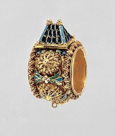 Jewish betrothal ring Date: 17th or 19th century Culture: Eastern European or Italian Medium: Gold, enamel Dimensions: 7/8 x 1-3/4 in. (2.2 x 4.4 cm) The Metropolitan Museum of Art