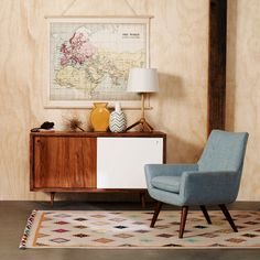 Soft retro armchair teamed with a modern nod to mid-century modern buffet  http://www.freedom.com.au/