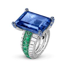 From de GRISOGONO's Love on the Rocks collection. The center stone is an emerald-cut blue sapphire adorned with carats of emeralds, which are surrounded by 60 baguette-cut white diamonds. Jewelry For Her, High Jewelry, Jewelry Rings, Sapphire Jewelry, Diamond Jewelry, The Sapphires, Emeralds, Schmuck Design, Beautiful Rings