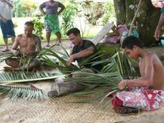 Samoan men weaving baskets from coconut palms.