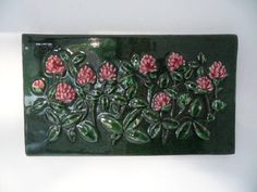 Sensational wall plaque ,made by Jie Gantofta,Sweden. Created by Aimo Nietsvouri Finest ceramic art wall picture. Number : With beautiful floral pattern. Height : x x inch. With slightly signs of use.