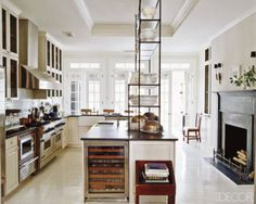 An antique Italian étagère in Darryl Carter's kitchen; the wine refrigerator is by Sub-Zero, and the range and hood are by Viking.