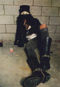 SLASH! I don't care if his music isn't from my generation I love this dude! This man can SHRED. I totally want those boots though. Im serious.