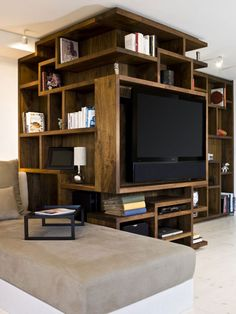 Awesome Brown Book Shelf Design Idea With White Books, White DEsk Lamp, And Black Television