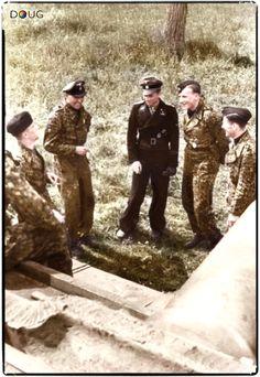 "s.SS-Pz.Abt. 101 ""LSSAH"", (l-r) Hans Höflinger, Georg Lötzsch, Michael Wittmann, Karl-Heinz Warmbrunn and Balthasar Woll stand in front of a Pz.VI 'Tiger' in France, May 1944"