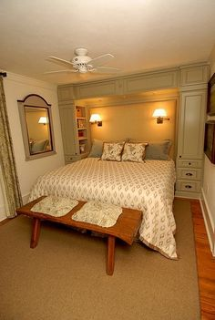 Side access in built in headboard/storage around bed.