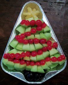 Christmas Fruit tray - use tree pan with fruit the kids like....green grapes and strawberries as well as pineapple & mandarin oranges as the star. Maybe have a dip in the 'trunk' of the tree.