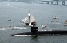 USS Rhode Island (SSBN 740) -  Look at that beautiful colonial ship next to the submarine.  The boys even came out in their whites to greet their visitors.  Awesome photo!