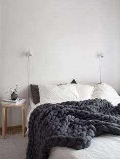 9 Creative Ideas For Adding A Nightstand To Your Bedroom // 9 Creative Ideas For Adding A Nightstand To Your Bedroom // A Simple Stool --- Keep bedside clutter to a minimum by using a small table that's just large enough for a book, a light, and some greenery.