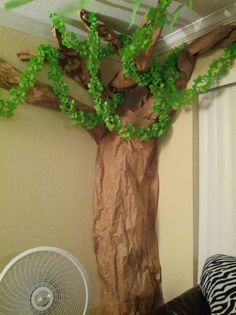Lion King Party - Paper African tree. For the tree I used about 2 rolls of brown packing paper from Wal-Mart. For the leafy vines I used green party decoration from Wal-Mart.