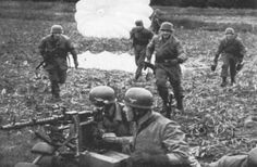 German Paratrooper in Action MG 34 in foreground